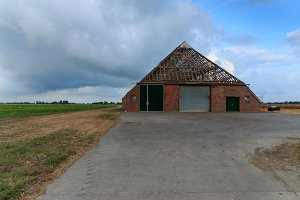 Farm without tiles on roof in The Netherlands