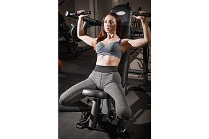 The fitness woman weightlifting workout in gym