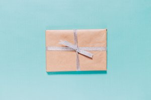 gift in box with silver ribbon