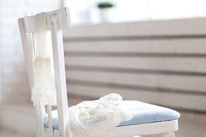 white nylon stockings hang on chair