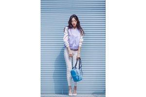 Asian fashion model outdoors