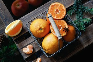 Oranges and tangerines in basket