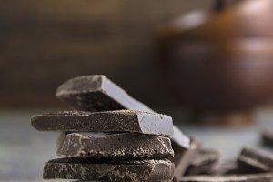 chocolate&#x3B; pieces&#x3B; dark&#x3B; background&#x3B;