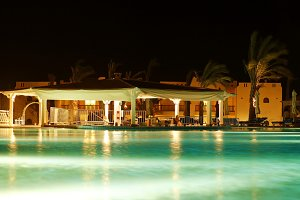 night view of the pool and bar