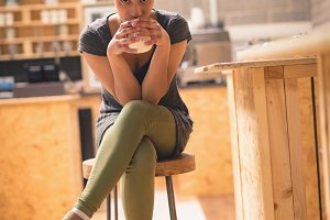 Woman drinking cup of coffee in café