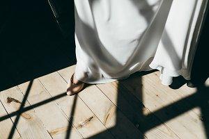 Bride Putting On Wedding Shoes. Artwork