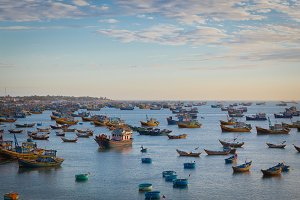 Vietnam village fishing boats ships sunset light