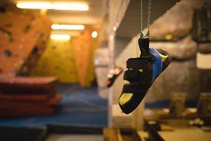 Footwear hanging in gym