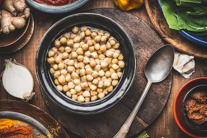 Cooked chick peas in dish with spoon