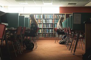 Female students sitting in library