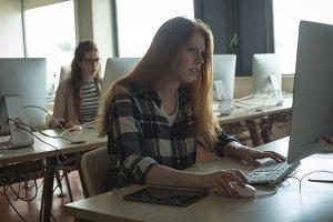 Women working on desktop computer