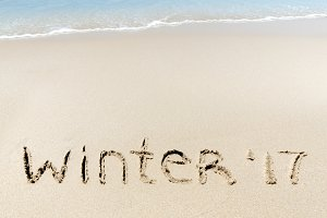 Winter 2017 sign sand near sea ocean tropic beach