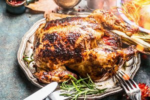 Roasted chicken or turkey on table