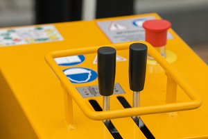 Levers for controlling mobile construction equipment - orange body