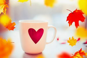 Mug with heart and fall leaves