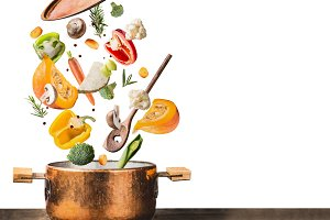 Cooking pot with flying vegetables