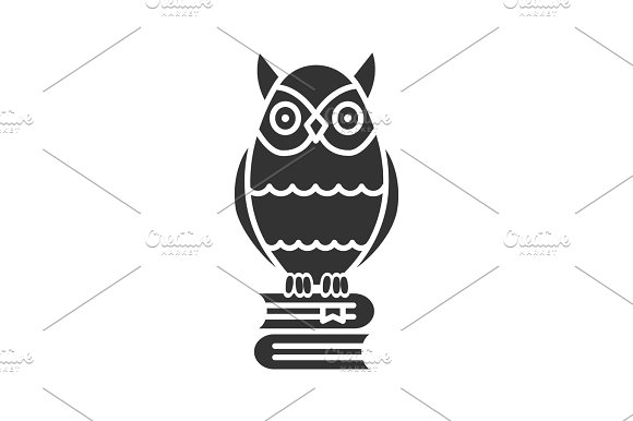 Owl on books stack glyph icon