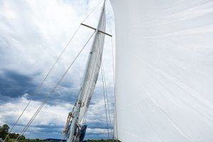 white sail against the cloudy sky background