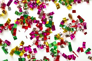 close up of confetti on white background