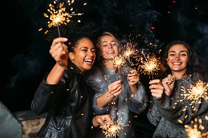 Young friends with sparklers