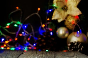 Christmas background with wooden boards and Christmas decorations, blurry, selective focus