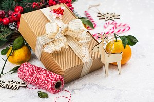 Christmas present with golden sparkles ribbon on Christmas decorated background