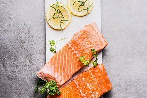 Raw salmon fillet on cutting board