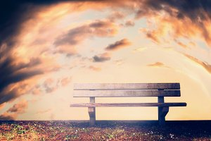 Lonely Bench at sky background