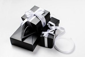 Many black gift boxes