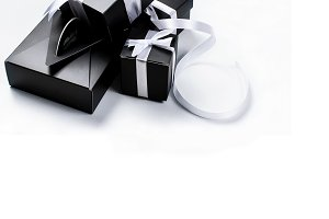 Black gift box with white ribbon