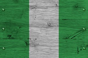 Nigeria national flag painted old oak wood fastened