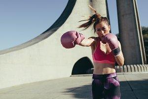 Sportswoman doing boxing working