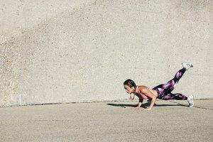 Young muscular woman doing core