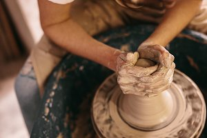 Potter moulding clay on pottery