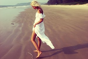 Girl in a white dress by the sea