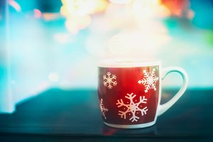 Winter mug of tea with snowflakes