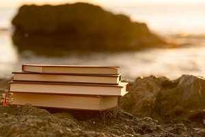 Several books by the sea