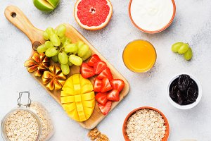 Top view of healthy breakfast with oats and fruits