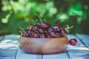 Bowl with ripe cherries