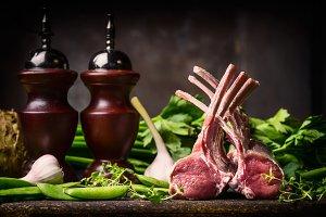 Raw racks of lamb cooking