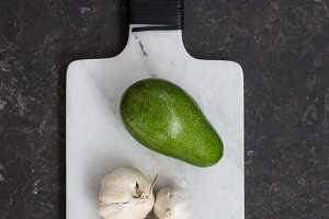 Fresh avocado and garlic over marble board