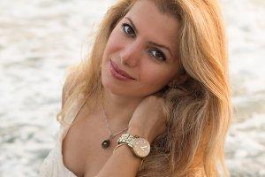 Beautiful blonde woman by seaside