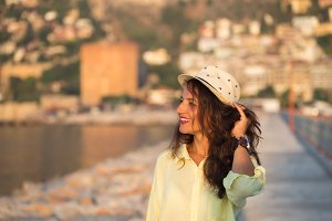 Summer travel concept. Traveller woman wearing biege hat