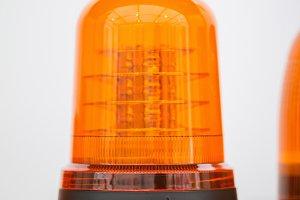 Orange flasher stand alone in exhibition