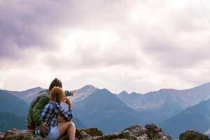 lovers cuddle on top of the mountain