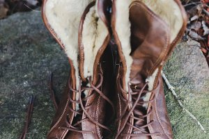 Brown Leather Lace Up Boots on Rock