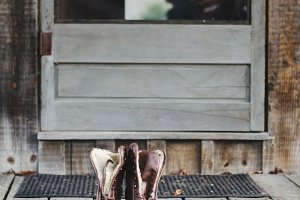 Brown Leather Boots on Cabin Porch