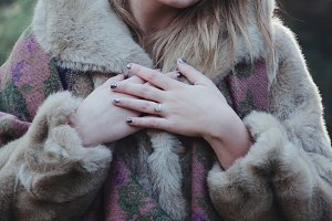 Engaged Woman in Vintage Fur Coat