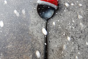 Holiday Christmas food background concept. Christmas menu concept. Cutlery spoon with Christmas decoration, stone background, Copy space. Snow effect