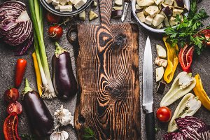 Cutting board, knife and vegetables